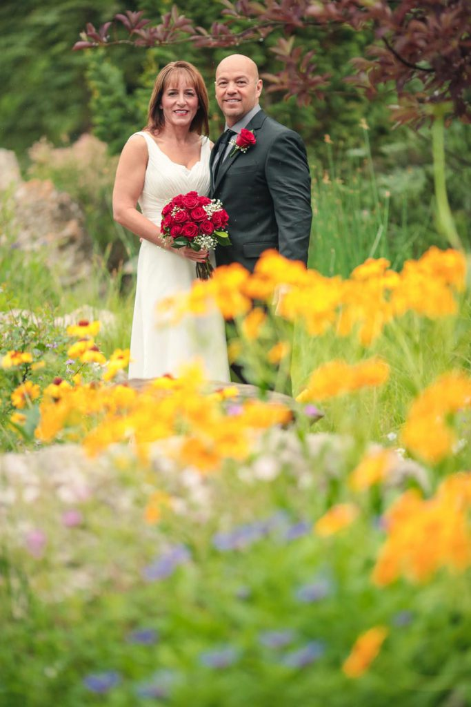 Couple amid wildflowers - eloping in Vail