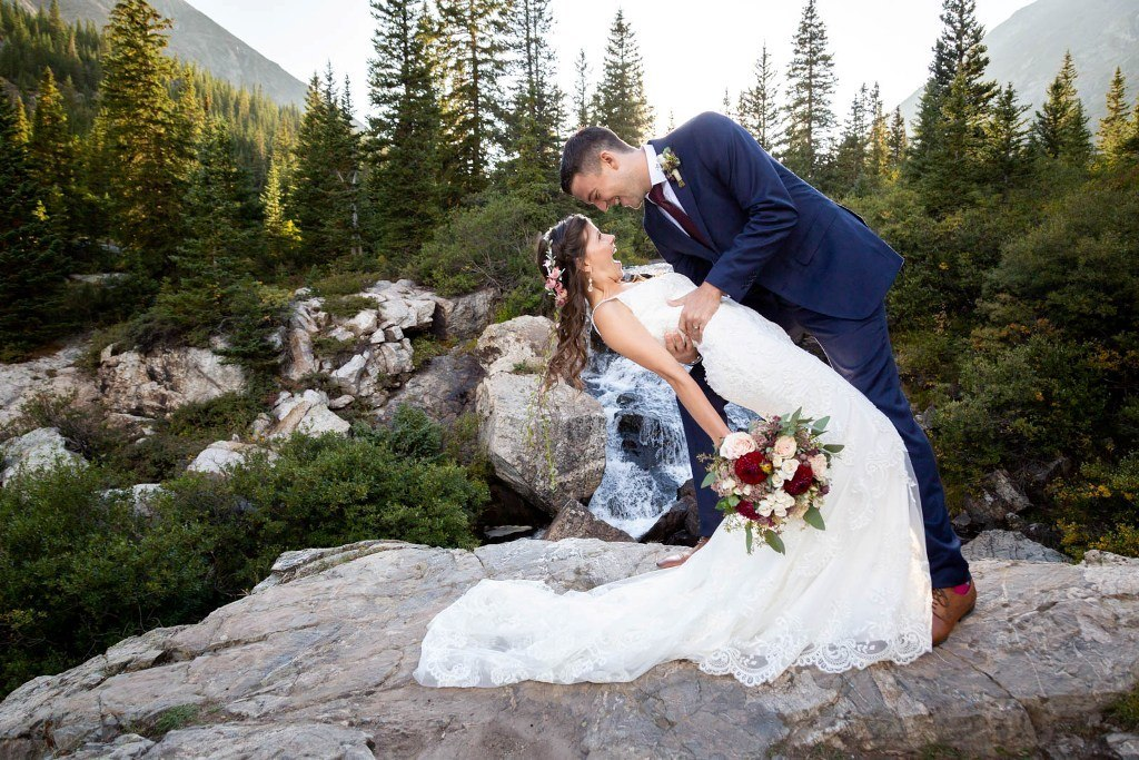 elope at a waterfall in Colorado