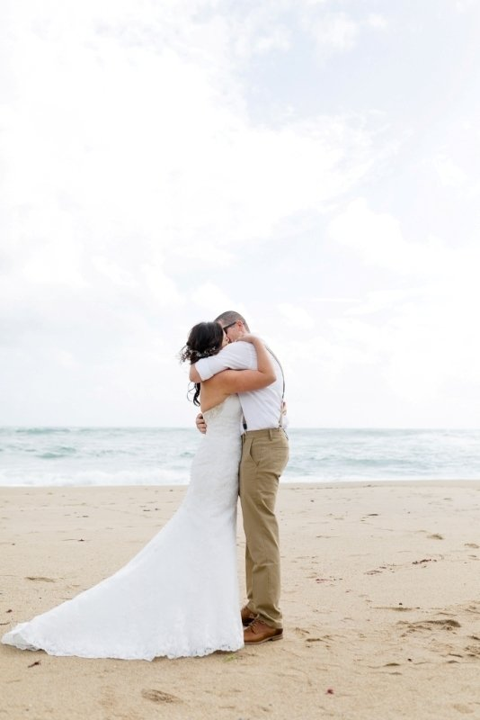 kissing on the beach after being married in Santa Cruz