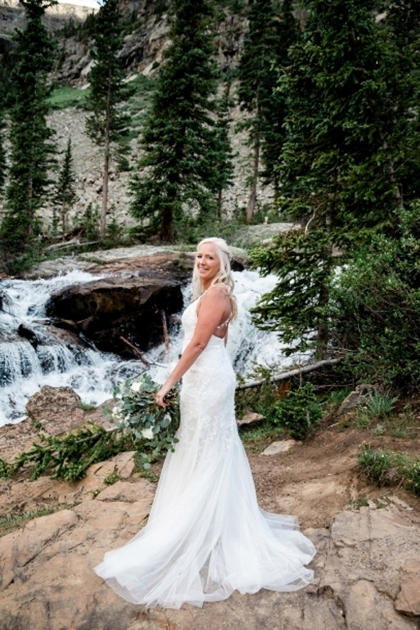 Colorado bride in front of the waterfall