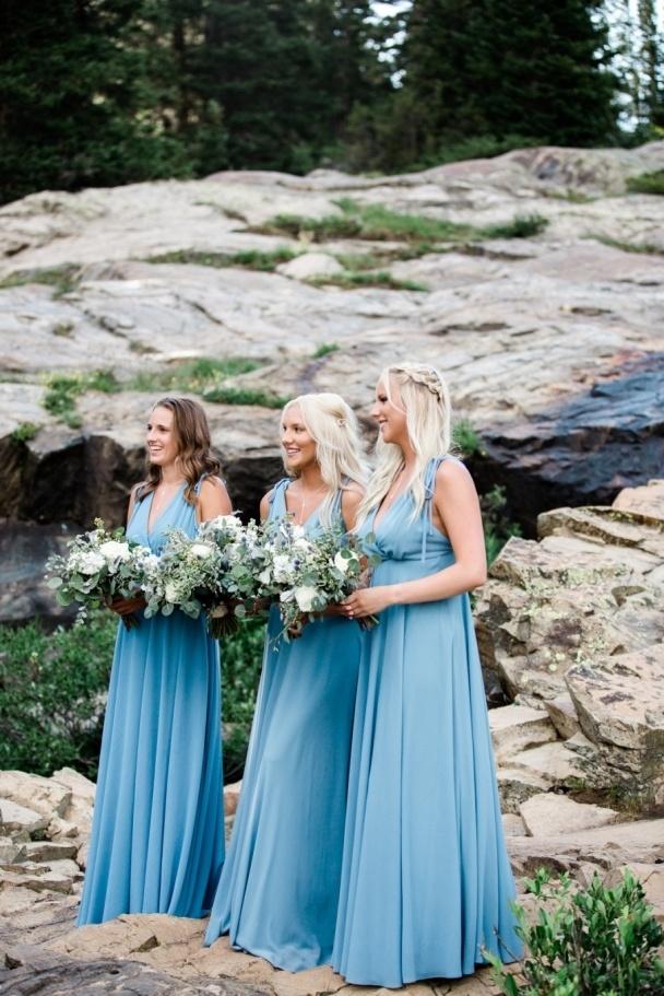 Three daughters watching waterfall ceremony