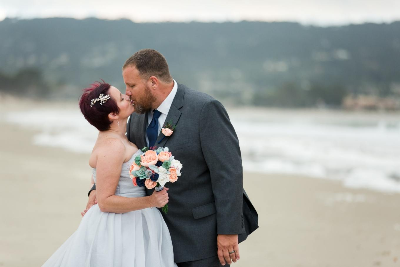 kissing in the surf - Monterey elopement