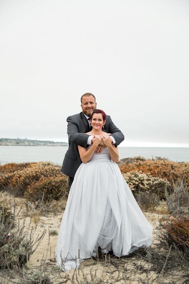 hugging after elopeing - Del Monte beach Monterey