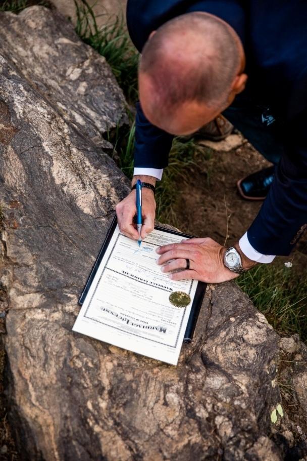 Matt signing the Colorado marriage license