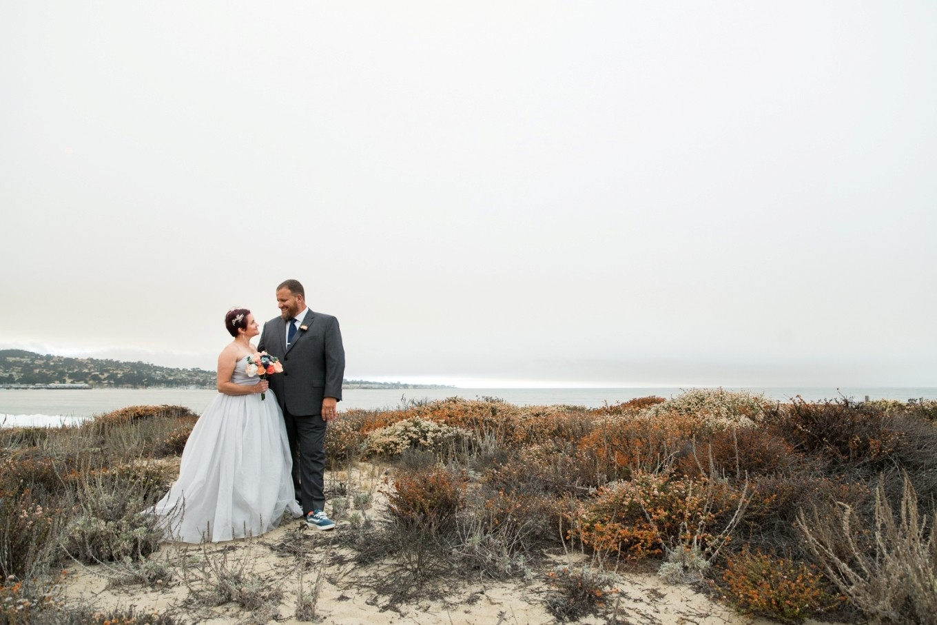 standing on the beach in Monterey after eloping