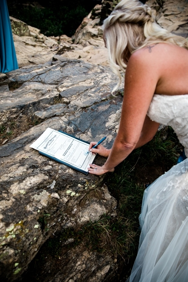 Laura signing the marriage license