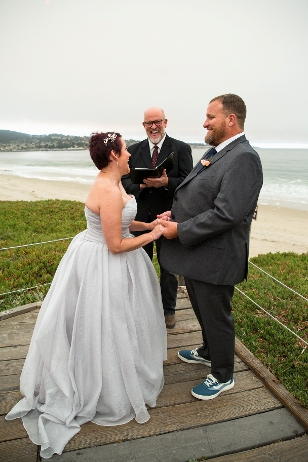 exchanging vows on the beach in Monterey