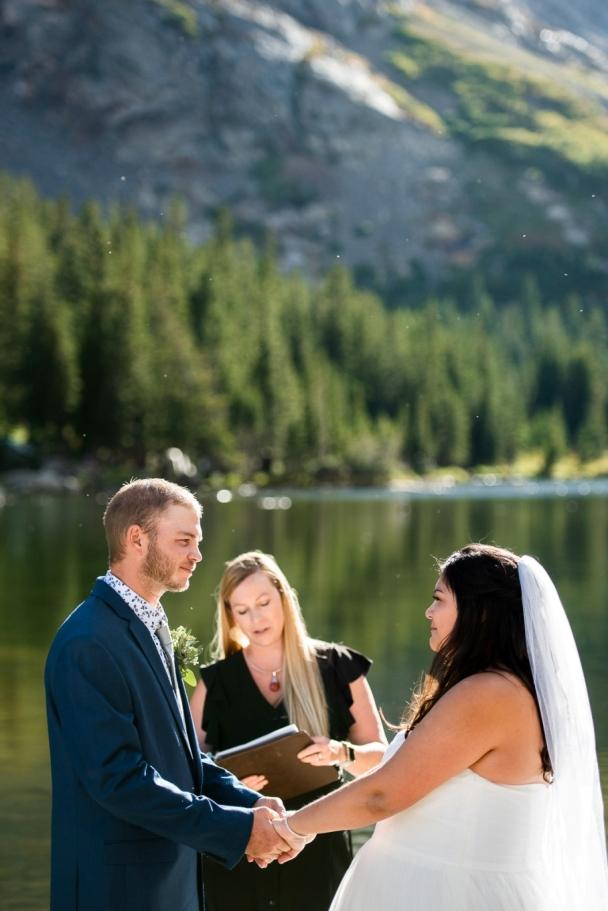 exchanging vows - Breckenridge micro-wedding