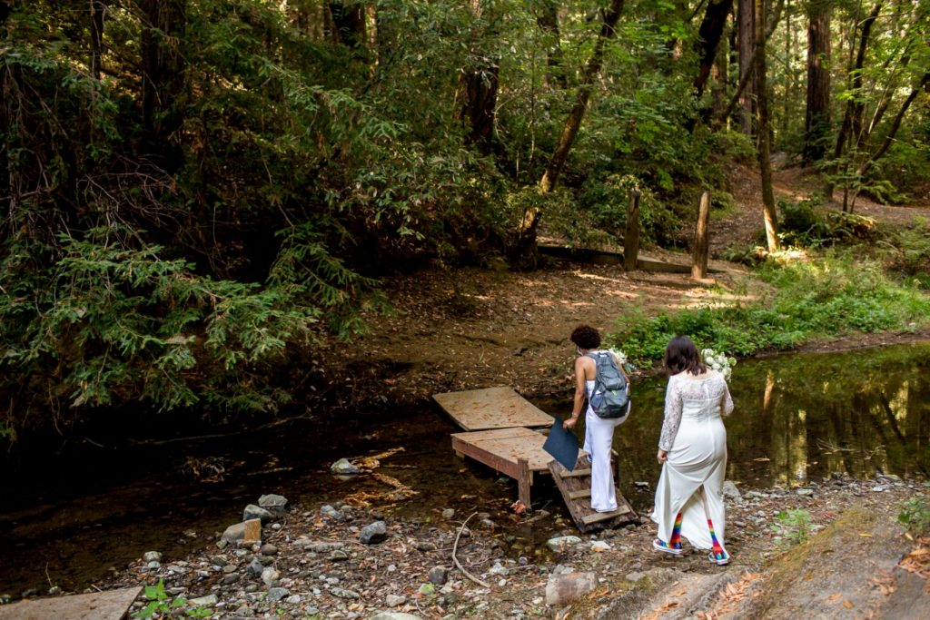 arriving in the redwoods for their wedding ceremony