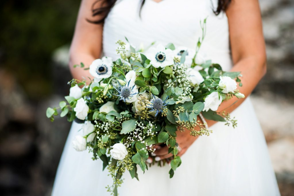 bridal bouquet in white, dusty blue and greens