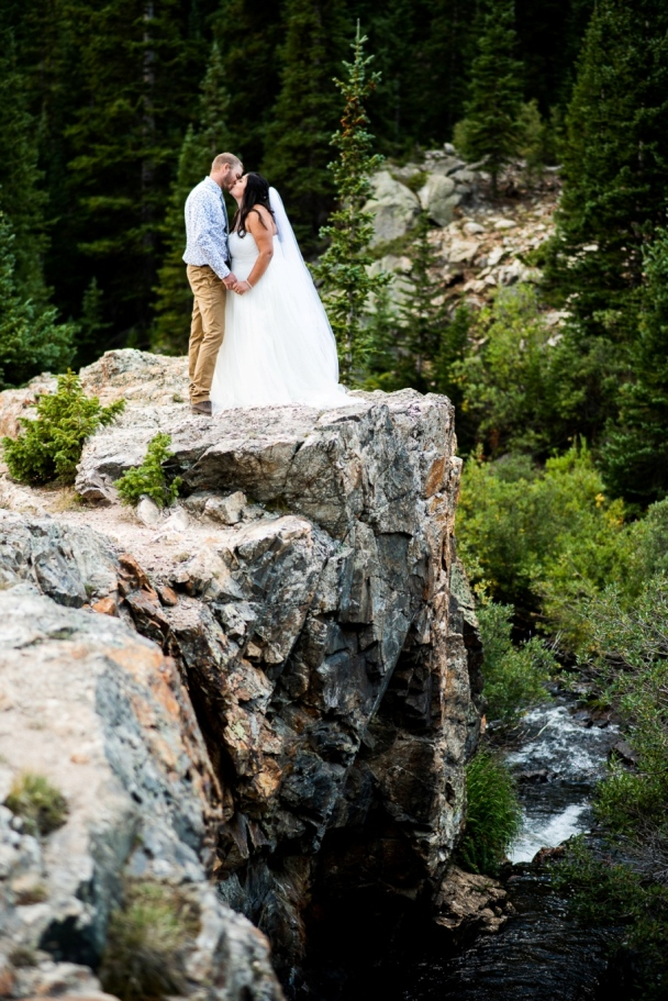 bride and groom standing on the cliffs