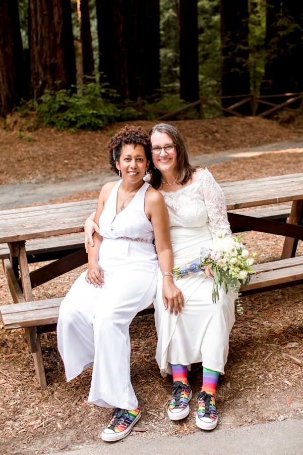 Hally and Majia on a picnic bench in the redwoods
