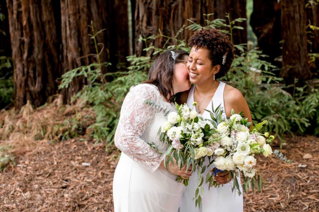 two brides with matching bouquets