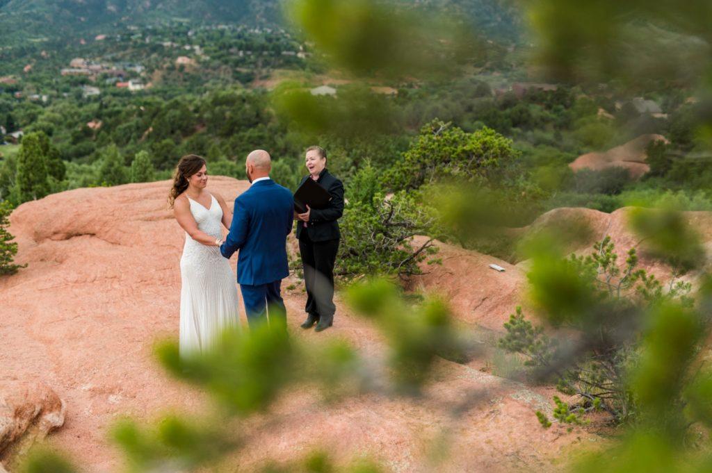 wedding ceremony through the trees