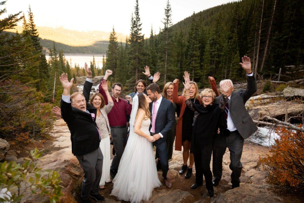wedding guests waving